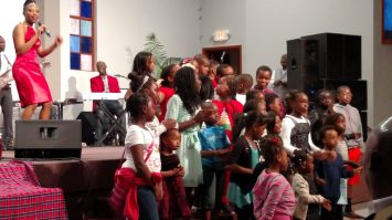 Angela singing with her two girls, Faith and Hope, and the whole bunch! Exuberant kids singing for Jesus!